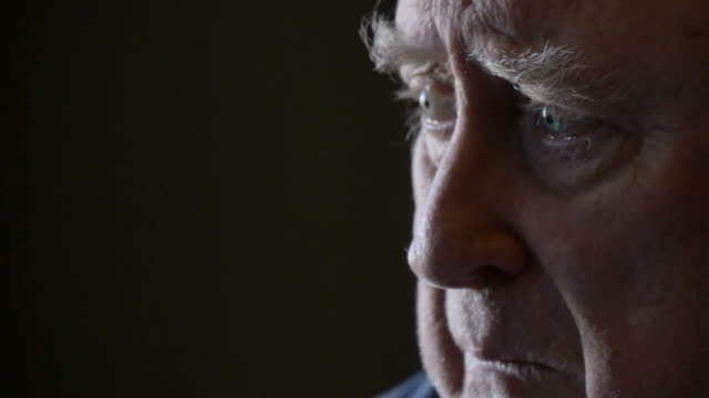 Grieving elderly man bereaved with grief and sadness video