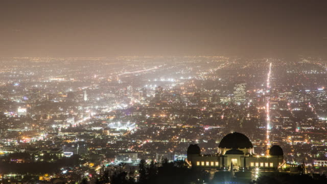 Griffith Park Observatory and the Long Streets of Los Angeles Skyline at Night: Timelapse video