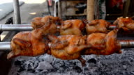Grill chicken roll with steel stove machine. video