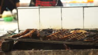 Grill fresh water fish in South East Asia local wet market video