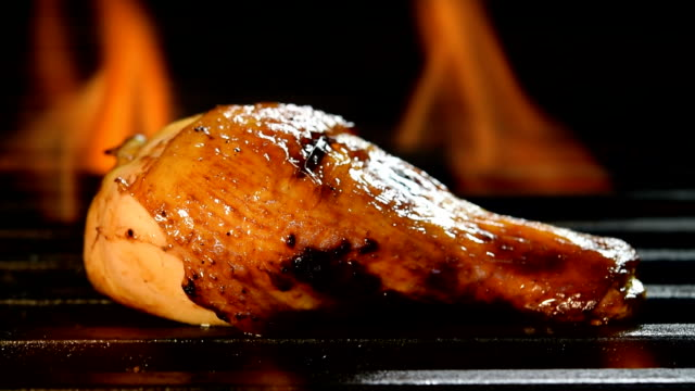 Grilled chicken legs on the flaming grill video