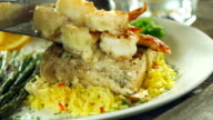 Grilled mahi mahi topped with buttery shrimp. video