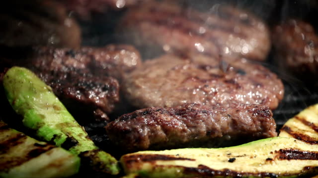 grilled meat and vegetables  on a fire video