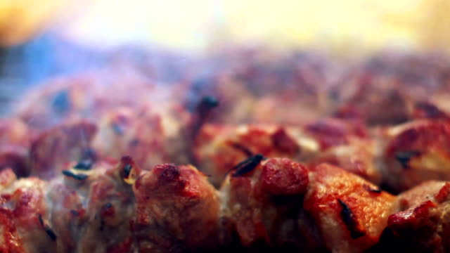 Grilled meat with smoke. Closeup. Arabic food. Cooked meat with crust video