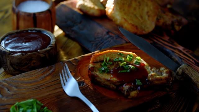 Grilled pork chops on wood video