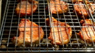 Grilled pork steaks over flames and coals, on the brazier, cam moves to the right, close up video