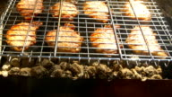 Grilled pork steaks over flames and coals, on the brazier, turn and put video