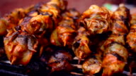 Grilled seafood on skewers. Street food. Grilling seafood on skewers and sticks video