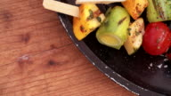 Grilled vegetables on a vintage wooden table video