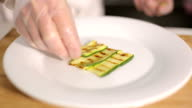 Grilled zucchini served on white plate by chef video