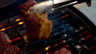Grilling BBQ Beef Steak on Gas BBQ grill. Chef is cooking asian style grilled beef on a BBQ grill. video