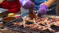 Grilling bbq squid, Street Food, Asia night market video