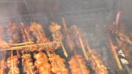 Grilling Chicken with a lot of smoke video
