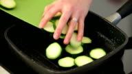 Grilling fresh zucchini in the black pan video