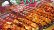 Grilling Squid at Traditional Street Food Market, Thailand video