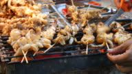 Grilling squid, Street Food, Thailand video