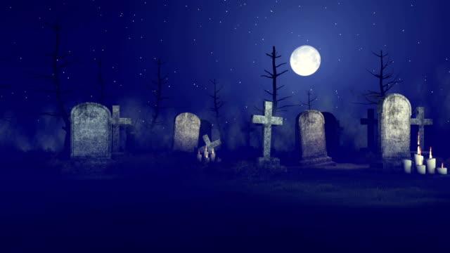 Grim reaper at spooky night graveyard video