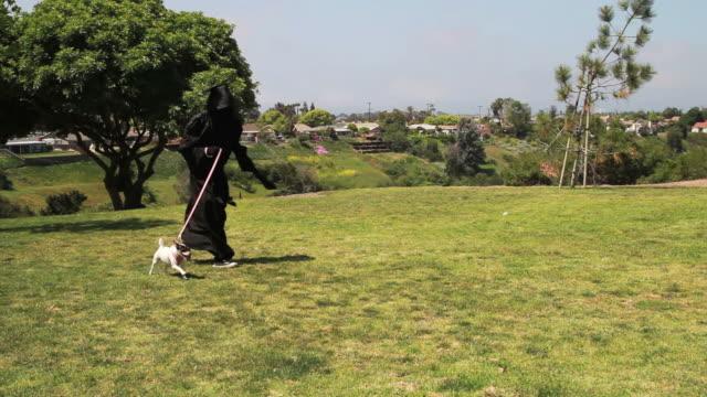 grim reaper runs with dog video