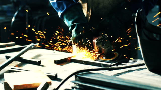 Grinding a metal rod in slow motion. video