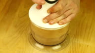 Grinding amaretti biscuits in a blender video