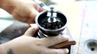 Grinding coffee beans with an old hand coffee grinder. video