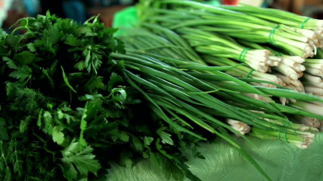Grocery market. Bunches of greens at stall video
