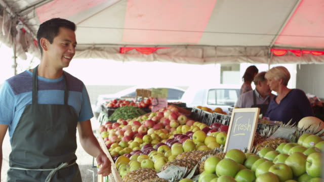 Grocery salesman labeling fresh fruits video