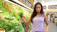 Grocery Store Woman Picks Out Produce video