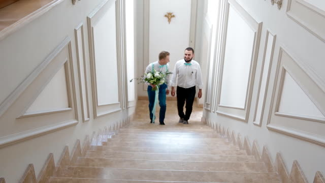 Groom and groomsman going upstairs video