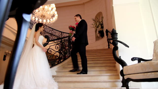 groom gives a bouquet to bride video