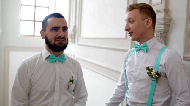 Groomsman talking and laughing with groom video