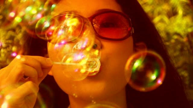 Groovy girl blows bubbles. video