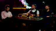 Group Boys smoking hookah in the lounge caffee video