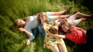 Group Of 4 Girls Relax In A Field And Have A Conversation (Shot From Above) video