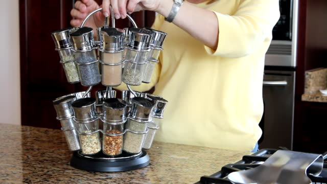 Group of a jar spices in rack video