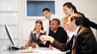 Group of a many business people discussing in the office. video