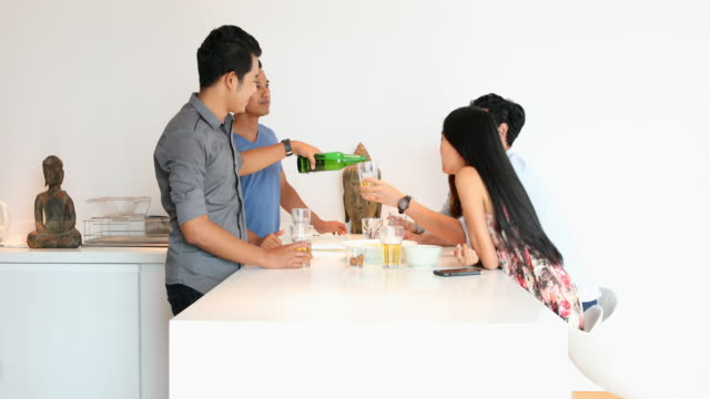 Group of Asian Friends Talking in the Kitchen at a Party video