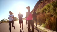 Group of athletes jogging outdoors video