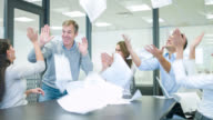Group of business people celebrating an achievement video