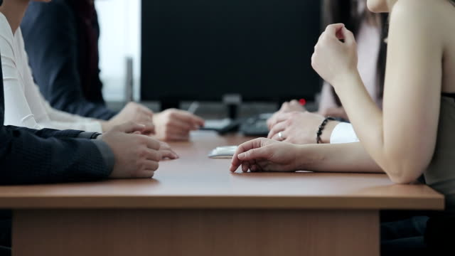 Group of business people meeting around table video