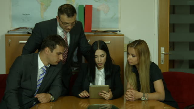 Group of business people planning work  in office video