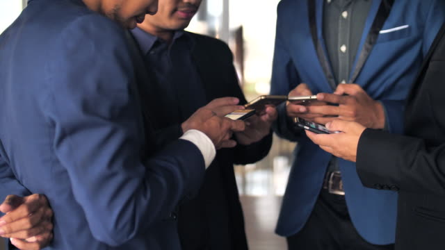 Group of business using phone video