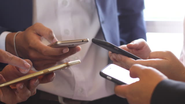 group of business using smartphone video