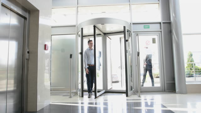 Group of businessmen entering office building video
