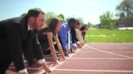 Group of businesspeople at starting line video