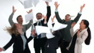 Group of businesspeople celebrate and throw papers video