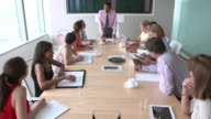 Group Of Businesspeople Meeting Around Boardroom Table video
