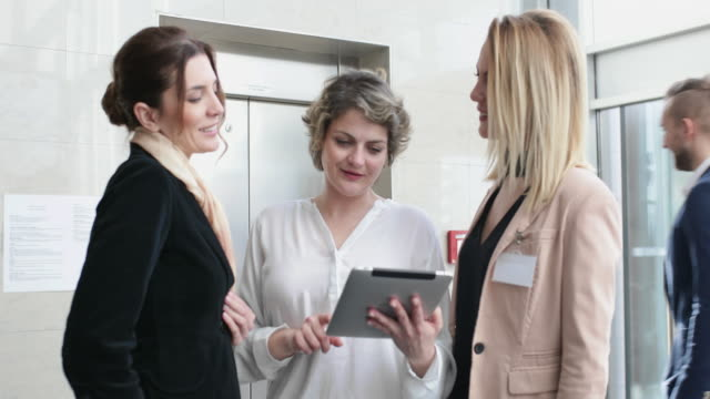 Group of businesswomen have informal meeting in the office lobby video
