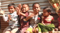 Group of Cheerful Rural Indian Children waving at camera video