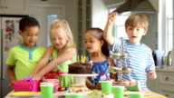 Group Of Children Celebrating Birthday With Cake And Gifts video